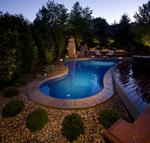 Small odd shaped pool-teak deck-outdoor lighting- fireplace