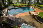 Large Backyard luxury pool overlooking lake-hot tub-wrought iron fence- terracotta deck-outdoor dining