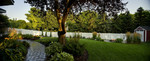curved paver path-fire feature-white privacy fence-