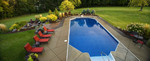Large geometric pool-elegant plantings-fire feature area-perfect lawn-red furniture