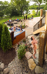 Outdoor shower-hot tub-fire feature lounge-lakefront-large patio-waterfall pillars