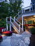 step lighting-natural large sone patio-landscape lighting-underdeck entertainment area-finished under deck and stairs