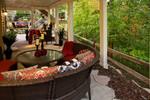 luxury landscape design-elevation-comfy outdoor furniture-finished under deck-elegant