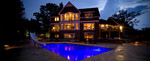 Large pool deck-dusk photo-pool lighting-pool slide