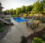 suburban pool-concrete deck-natural stone-dining area-2 level deck-plantings-pool slide-diving board