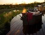 teak deck-sunset view-outdoor kitchen-outdoor couch-native plantings-sublime location