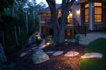 Very small backyard landscape design-landscape lighting-large stepping stones-decrative boulder-woods-rear elevation