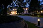 paver driveway-in ground landscape lighting-dusk-mansion