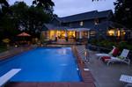 dusk photo-pool fountain-pergola-landscape lighting