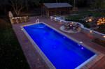 dusk lit pool fountains-dinning room structure
