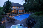 Native plantings and pool fountains-woods-dusk pool lighting