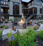 mansion-stone-pavers-firepit-flowers-high end outdoor furniture