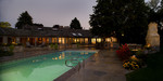 large outdoor fireplace-dusk pool photo-rambler