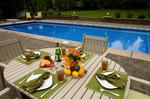 table setting overlooking long pool-serene setting