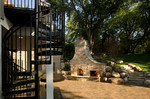 spiral staircase-large outdoor fire place-stone steps-boulder edge