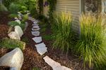 boulder retain wall and native plantings