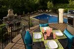 high view of large backyard pool/fireplace