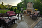 large outdoor fireplace/paver patio/high end outdoor furniture