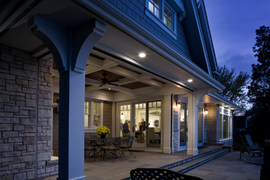 luxury home and porch looking in at dusk